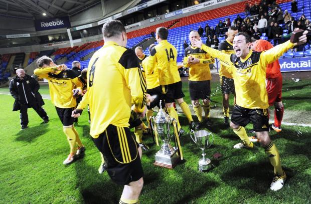 The Bolton News: Eagley celebrate winning the trophy in 2013