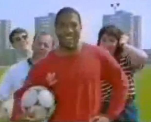 John Barnes rapping in New Order's World in Motion. Picture from YouTube.