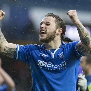 Stevie May scored a brace to take St Johnstone through
