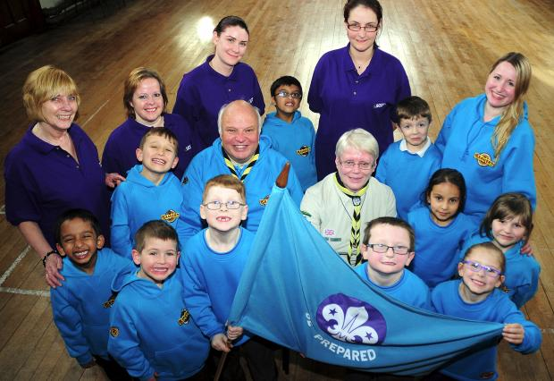 The 12th Bolton Beavers with, back, from left, assistant leaders Christine Ashton, Paula Williams, Kim Worthington, Tess Cooper and Danielle Fenn; centre, leader Clive Fenn, left, and acting group scout leader Hilary Marston