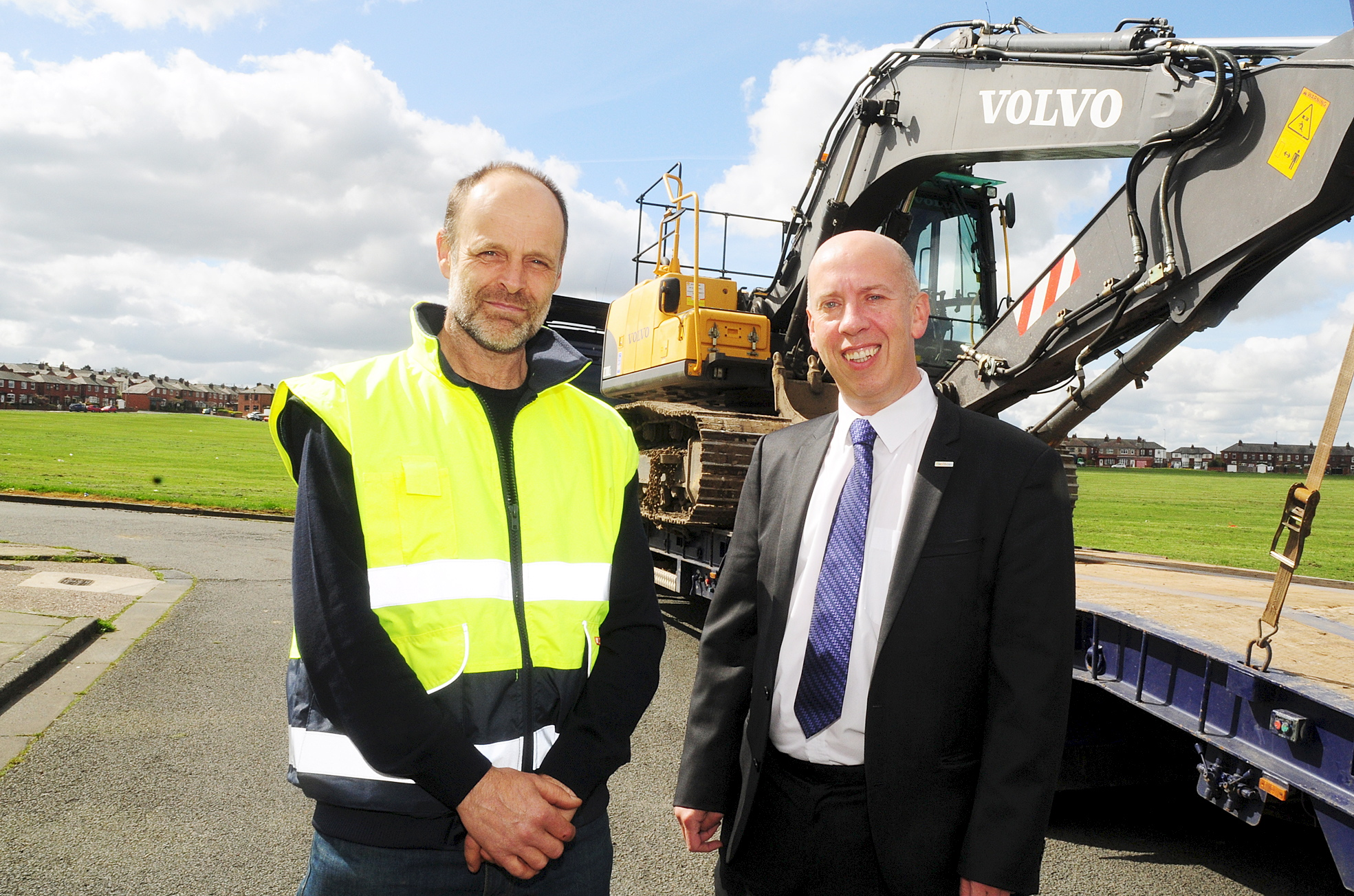 Duncan Ross, left, from Duncan Ross Land Drainage in Bolton with Cllr Nick Peel at Hulton Lane playing fields