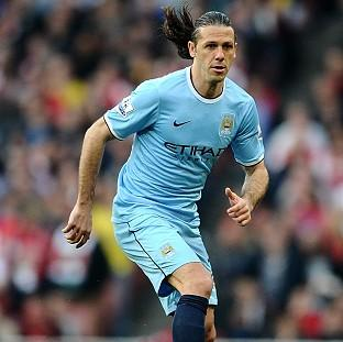 Manchester City defender Martin Demichelis insists title race is not over