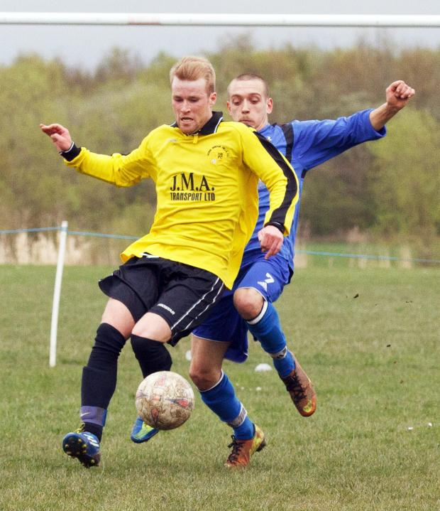 The Bolton News: Howe Bridge Mills player Shaun Farrimond, left, is closed down by Tottington's Andy Keefe on Saturday