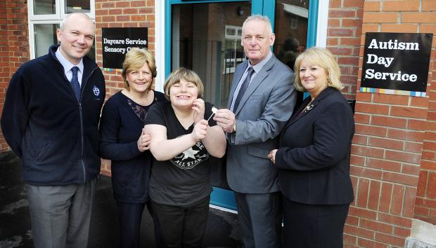 The Bolton News: At the opening of the new centre, from left, Chris Gallagher, contracts manager for GB Building Solutions, Amanda Plimley, Lucie Plimley, service user, Ian Proctor, disability and autism day service manager and Cllr Llinda Thomas