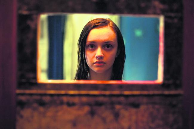 Olivia Cooke has a room with a view in the British horror film The Quiet Ones.