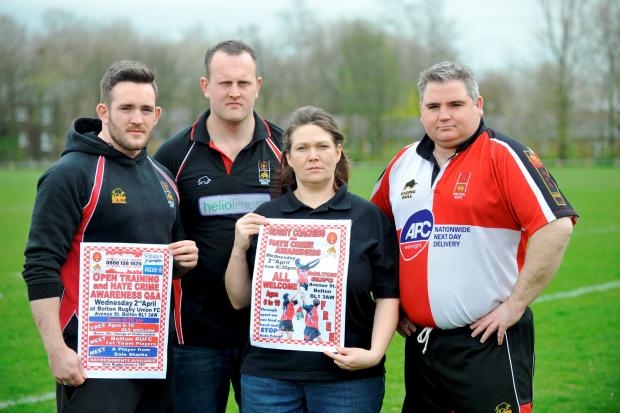 The Bolton News: From left, rugby team players Chris Cockton and Tony McLaughlin with Eraina Smith, safeguarding officer, and Jon-Paul Hardman, senior chairman, at Bolton Rugby Union Club's campaign against Hate Crime