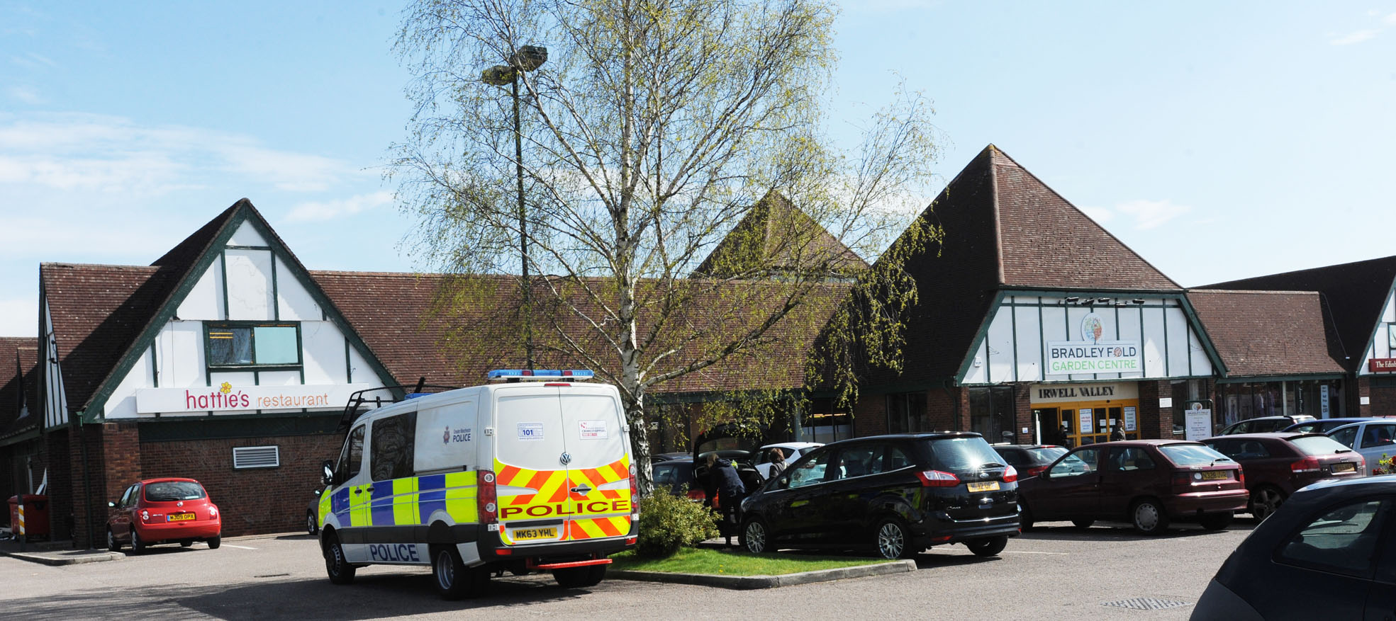 Police at Bradley Fold Garden Centre, where the missing three-year-old boy sparked a major panic