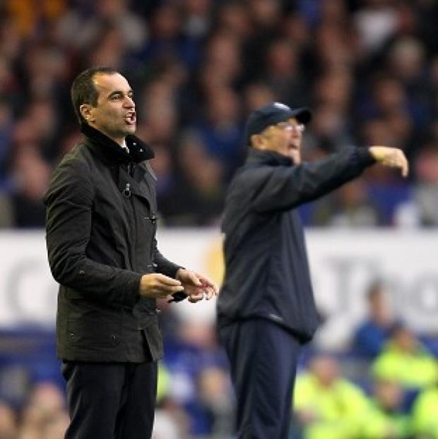 The Bolton News: Everton manager Roberto Martinez, foreground, was hurting after defeat to Tony Pulis' Crystal Palace