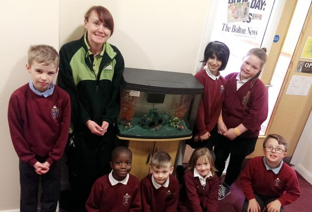 Pets at Home assistant manager Rebecca Jepson is pictured with children from Tonge Moor Community Primary School.