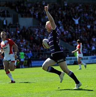Liam Farrell celebrates as he runs over to score against St Helens