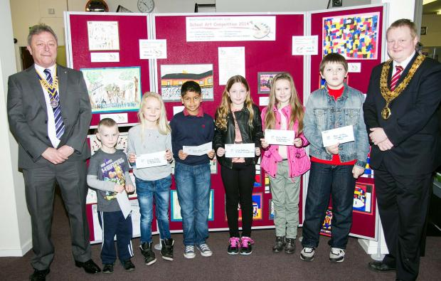 Pictured, from left, are Rotary President Arthur Price; Year Three winners Matthew Lomax who was representing his brother Nathan, Jasmine Ripley and Kian Patel and Year Five winners Chloe Battersby, Emelia Edgar and Peter Hartley and Westhoughton Mayor, C
