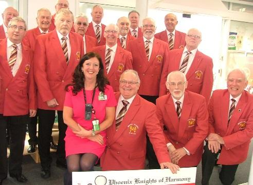 Christine Baldwin, event organiser, with members of The Phoenix Knights of Harmony barbershop singers