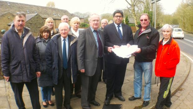 Resident Roy Adams hands the petition to Cllr Mudasir Dean