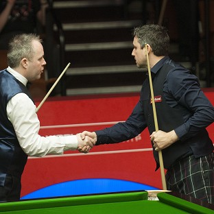 John Higgins, left, and Alan McManus shake hands after their match