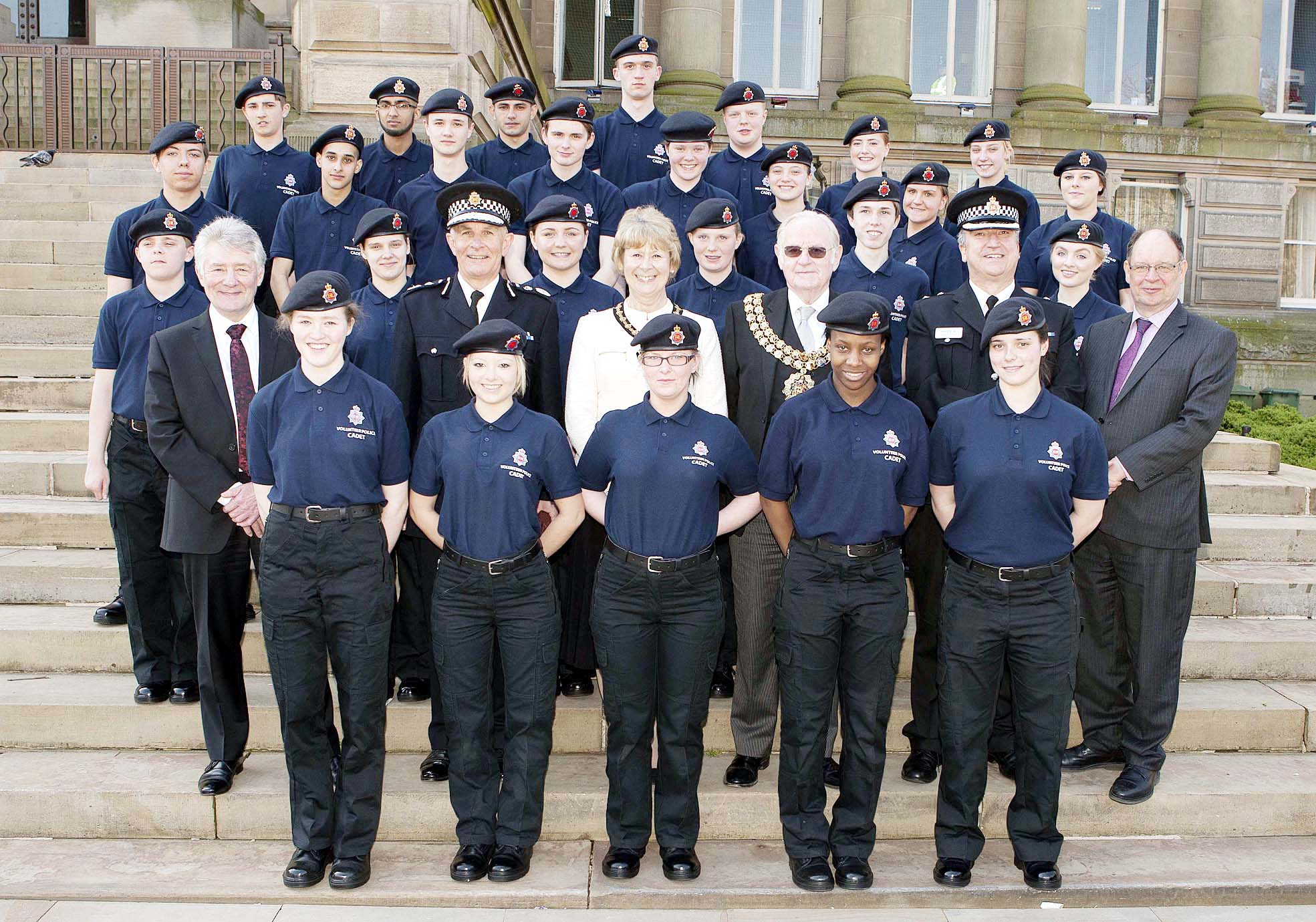 The cadets with police commissioner Tony Lloyd, Sir Peter Fahy, chief constable, Mayor and Mayoress of Bolton Cllr Colin Shaw and Dee Shaw, Ch Supt Shaun Donnellan, Bolton divisional commander, and Jim Battle, deputy police commissioner