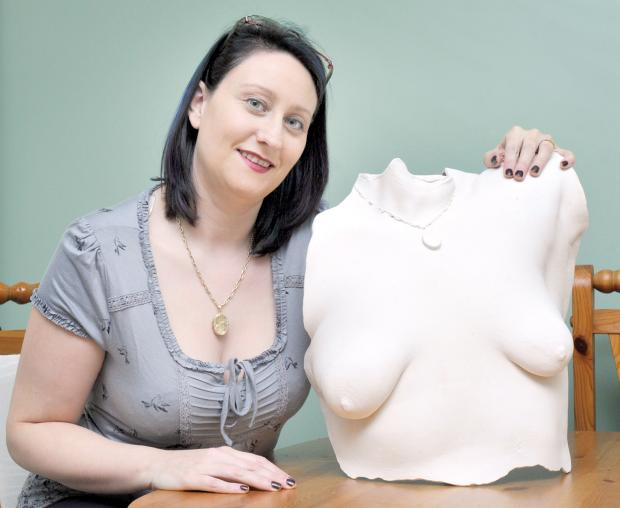 The Bolton News: Laura Peacock with a model of her own uneven breasts