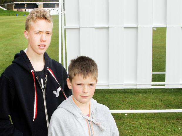 Brothers Cian and Ross Dickinson are members of the cricket club and were disappointed at the damage caused to the sight screens