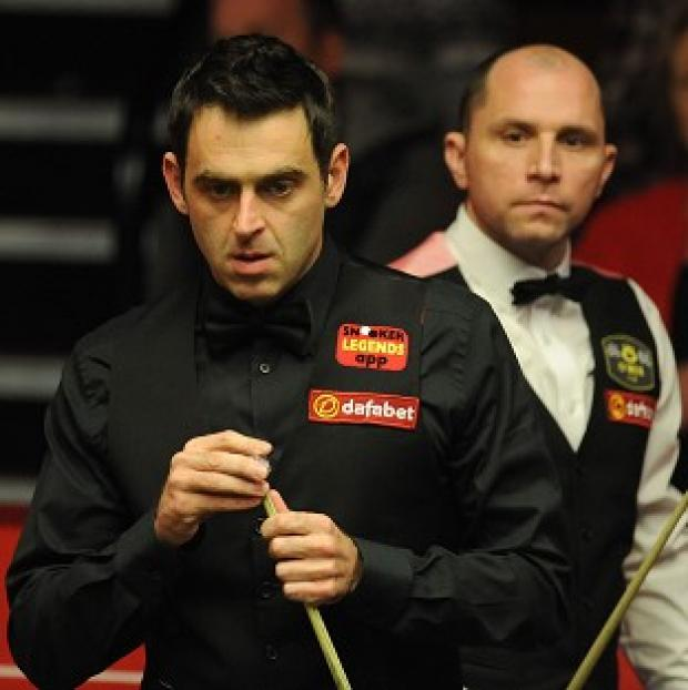 The Bolton News: Ronnie O'Sullivan, left, trails Joe Perry, right, by two frames
