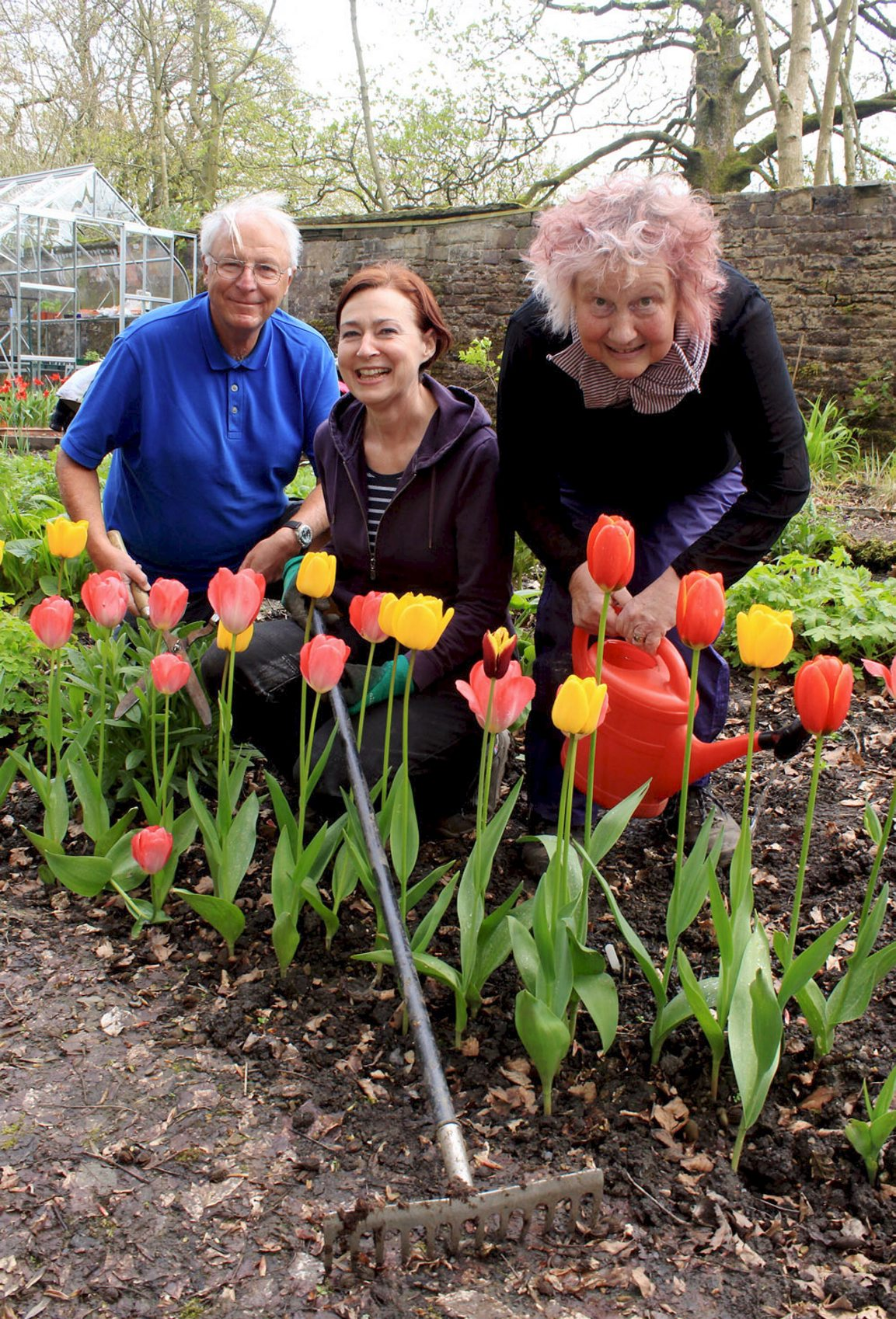 Gardeners plant flowers and vegetables in Turton Tower kitchen garden