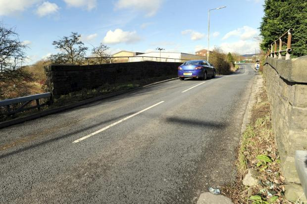 The Bolton News: Lostock Lane will be closed while work is carried out to the railway bridge, pictured
