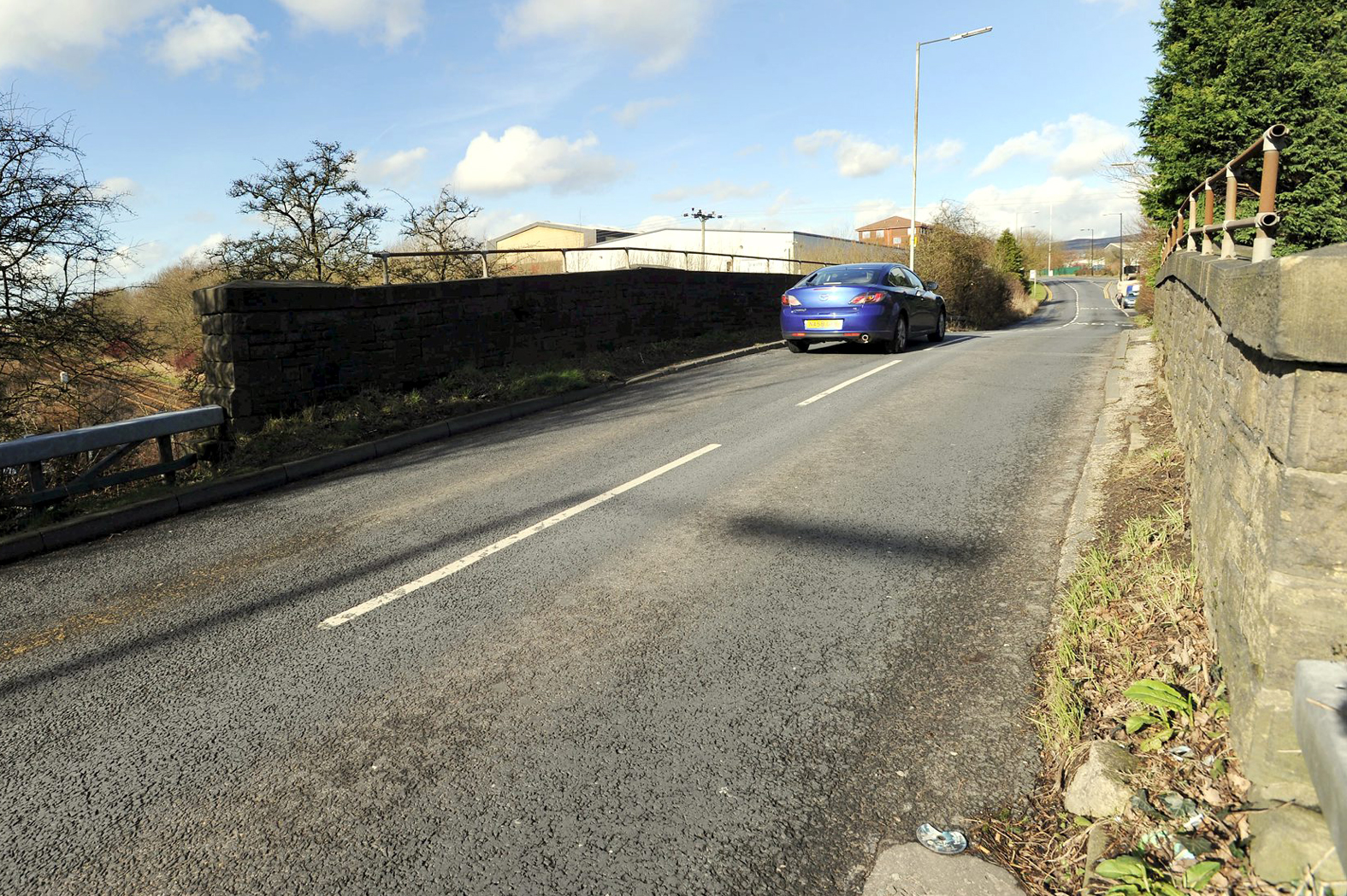 Lostock Lane will be closed while work is carried out to the railway bridge, pictured