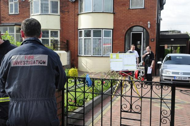 The Bolton News: Police and firefighters at the house in Wigan Road, Deane