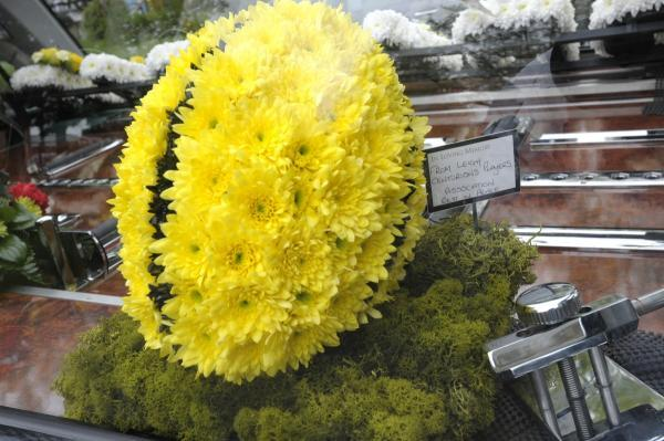 The Bolton News: Floral tributes at the funeral included this fitting rugby ball