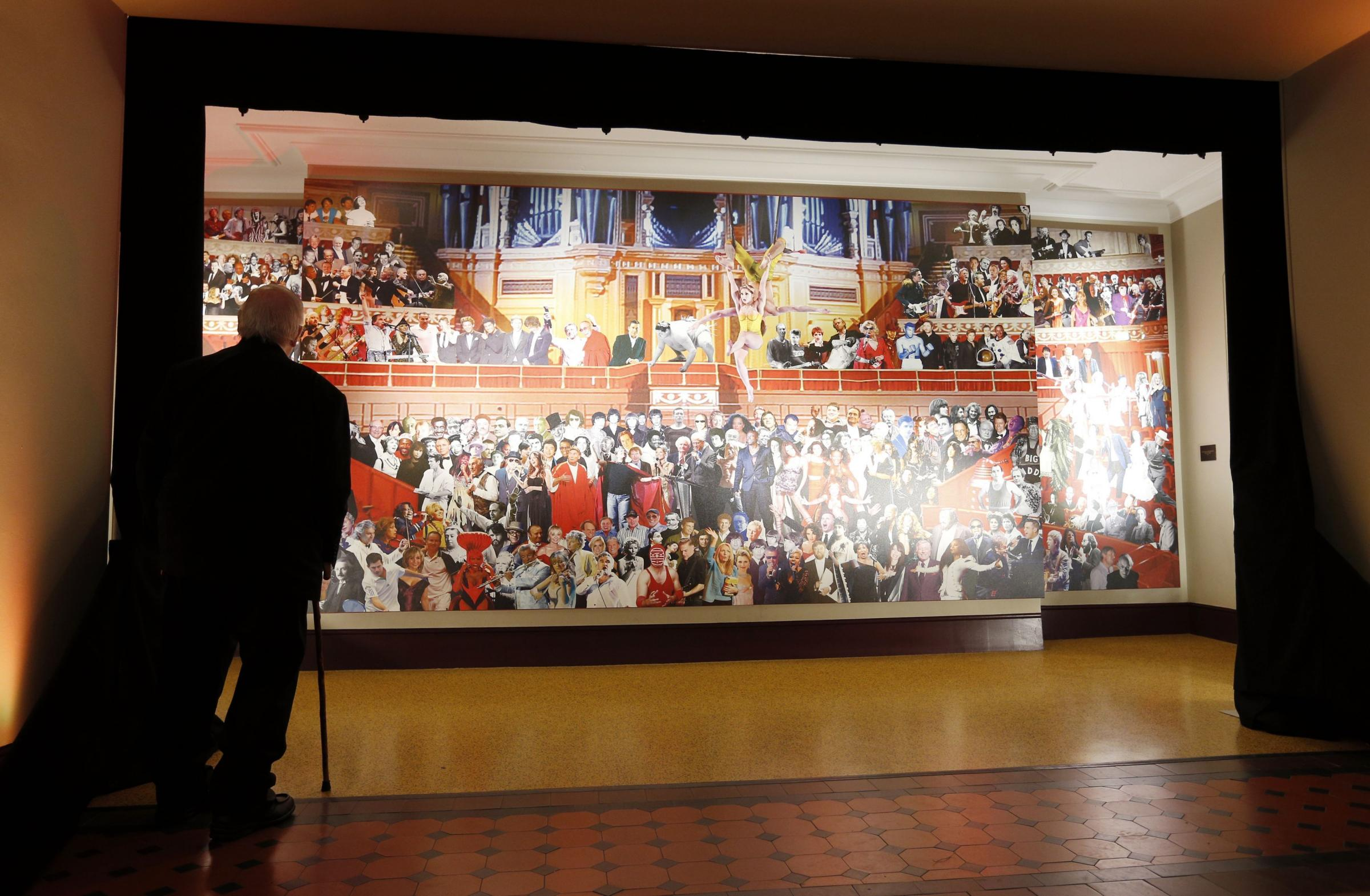 Sir Peter Blake next to his mural of Royal Albert Hall performers