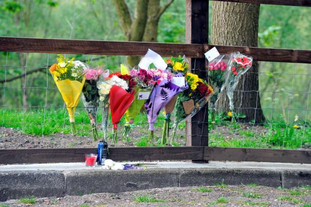 The Bolton News: Flowers and tributes left to 15-year-old James Jones, who was found hanged near Clifton Country Park on Monday.