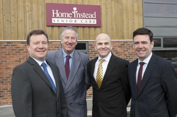 CEO of Home Instead Trevor Brocklebank, David Mowat MP with chief operating officer Martin Jones and Andy Burnham MP