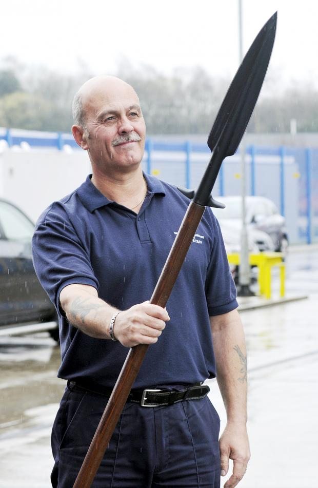 The Bolton News: Glyn Armstrong shows off a weapon similar to a medieval pike
