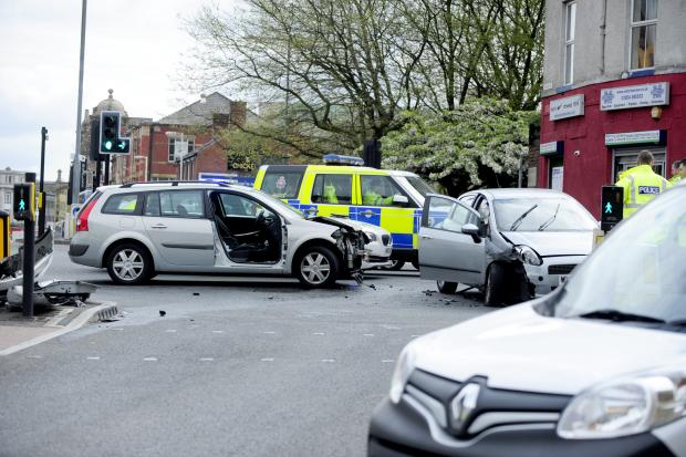 The Bolton News: The scene of the car crash in Moor Lane, Bolton, this morning