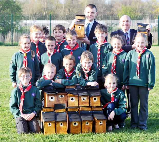 The Cubs present bird boxes to Bolton Barclay's Matthew Whitehead and Friends of Daisy Hill Station's chairman Cllr Jack Speight