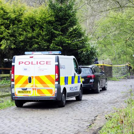 Police at the scene of the stables arson attack in Breightmet