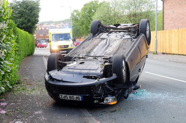 The Bolton News: The overturned car in Broadford Road, Ladybridge
