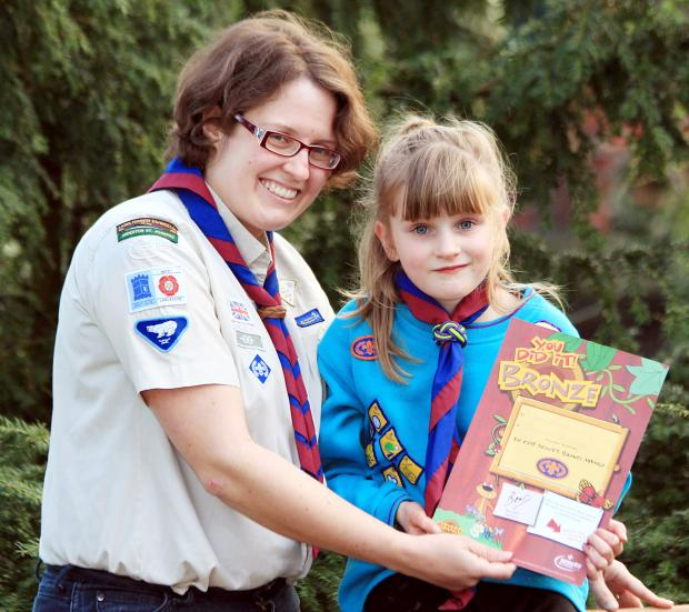 The Bolton News: Kate Wilcock with her Beaver Award and Beaver leader Sarah Moore at St Joseph's Church, Anderton