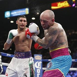 Amir Khan, left, believes he has what it takes to beat Floyd Mayweather after Luis Collazo, right, proved no obstacle