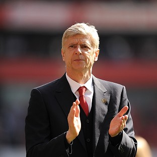 Arsene Wenger stressed that his future is with Arsenal