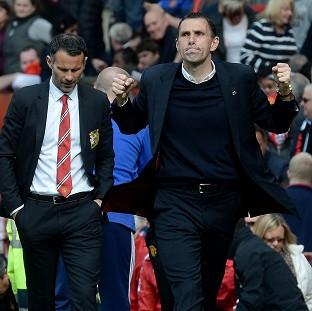 The Bolton News: Gus Poyet, right, refuses to take anything for granted after guiding Sunderland to the brink of Barclays Premier League safety