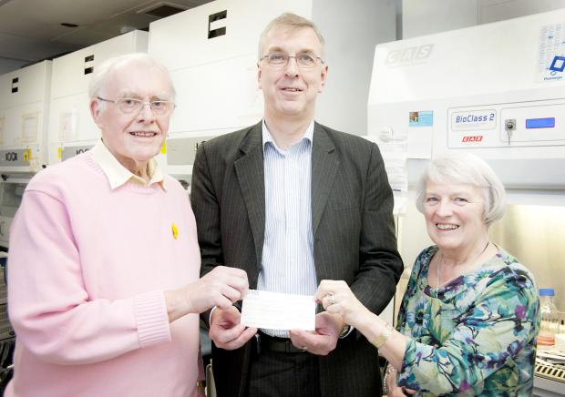The Bolton News: David Aspinall, left, with wife Sue and Professor Robert Hawkins