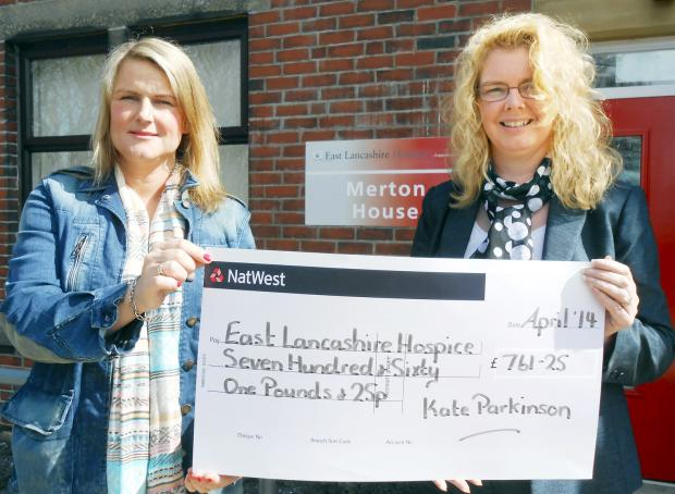 Kate Parkinson, left, presents a cheque to Sharon Crymble of the East Lancs Hospice