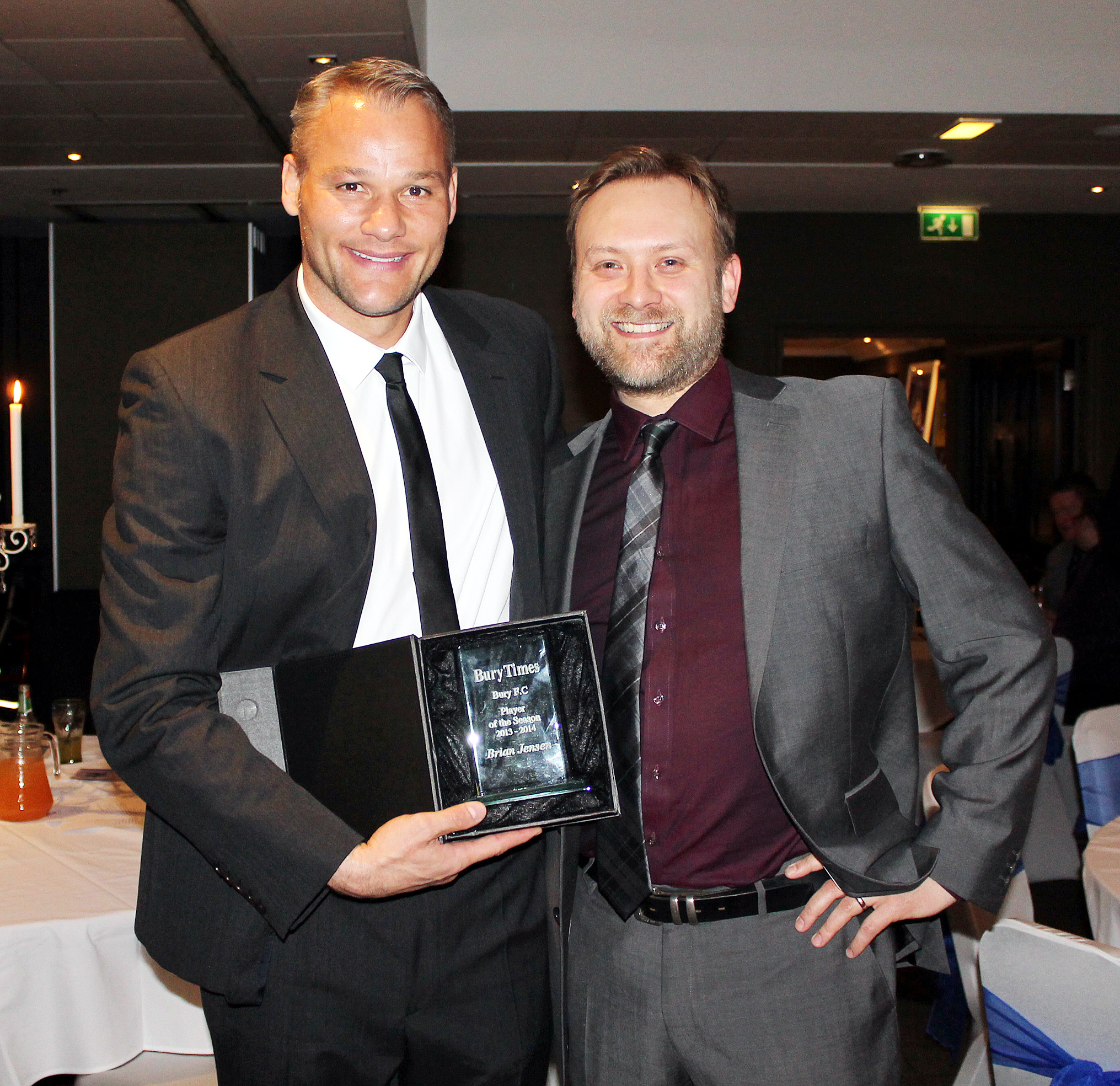 Brian Jensen picks up his Bury Times player of the year award from reporter Craig Nelson