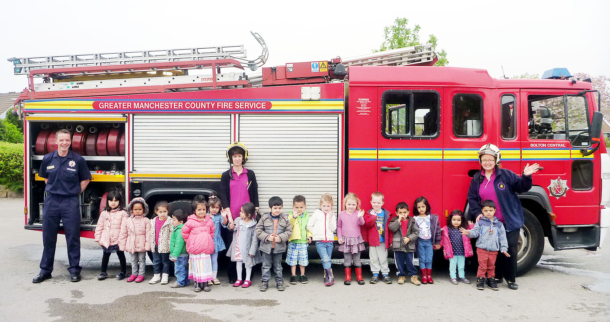 Children at Ladybridge Pre-School enjoy their visit from Bolton Central's White Watch