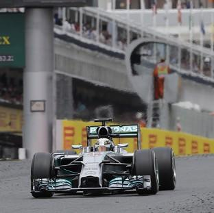 The Bolton News: Lewis Hamilton claimed victory in Sunday's Spanish Grand Prix (AP)