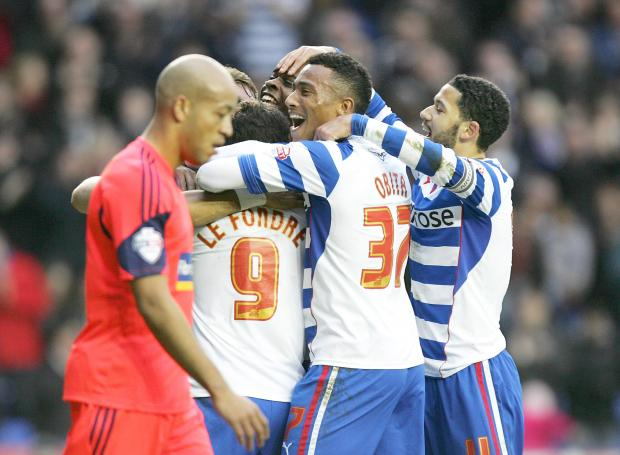 Alex Baptiste  Alex Baptiste trudges past celebrating Reading players after one of the seven goals