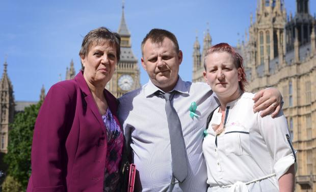 The Bolton News: Michael Lomas and Shirley Anderson with MP Julie Hilling, outside parliament, when they lobbied for changes to the dangerous dog laws