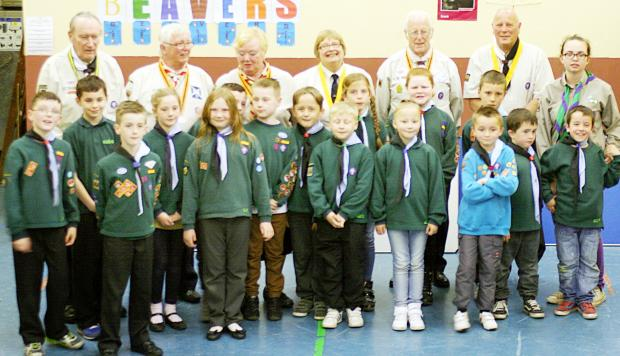 With young scouts are, back from left, the Rev David Allen, Bill White, Gwen White, Sue Raine, Paul Raine and John Greenhalgh