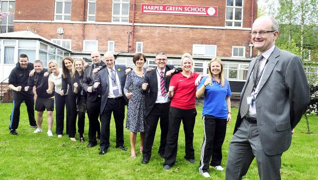 Harper Green School headteacher,  Andrew Foster, right, with the group of teachers who will be taking part in the Great Manchester 10K Run on Sunday