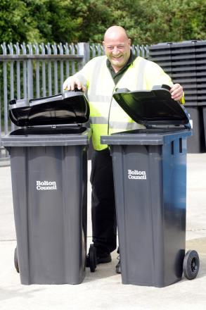 Recycling officer Chris Neal with the normal bin on the left and the smaller one on the right.