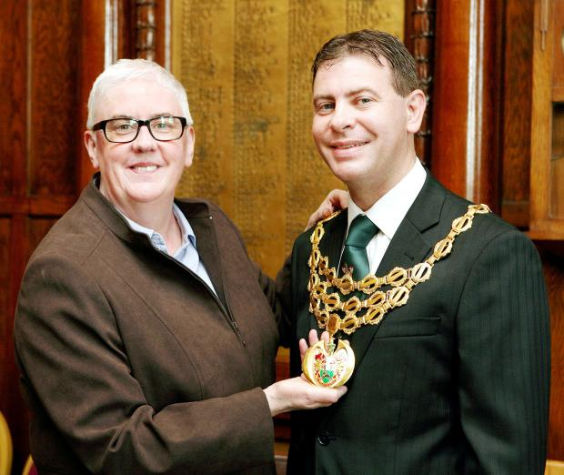 The new mayor of Horwich, Cllr Richard Silvester, receives the chain of office from retiring mayor Cllr Christine Root